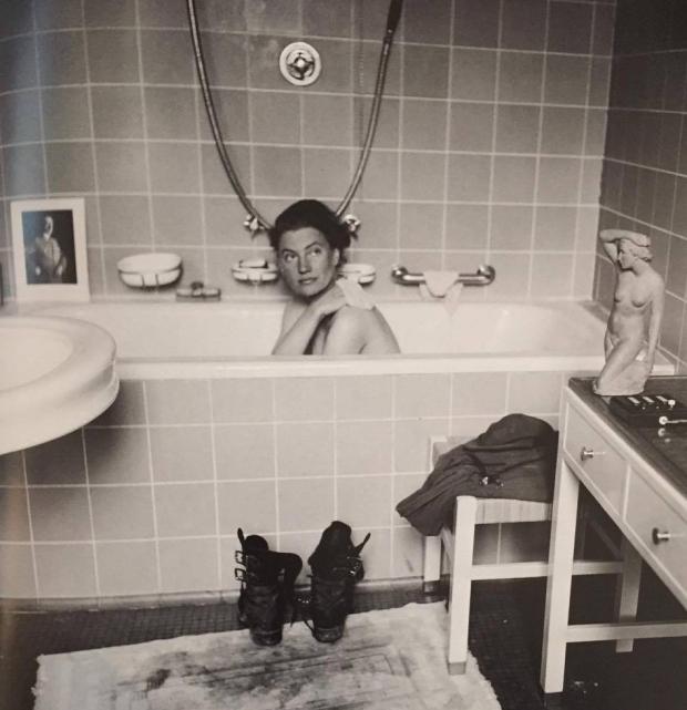 Lee Miller in Hitler's bath, Munich, Bavaria Germany. April 1945, David E. Scherman. Image Credit: A Bow-Bertrand