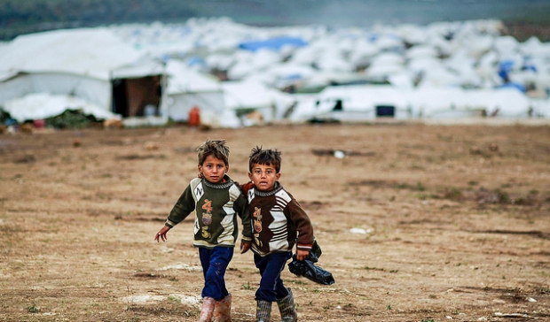 Two Syrian boys on the outskirts of a temporary camp. Credit: Freedom House, Flickr