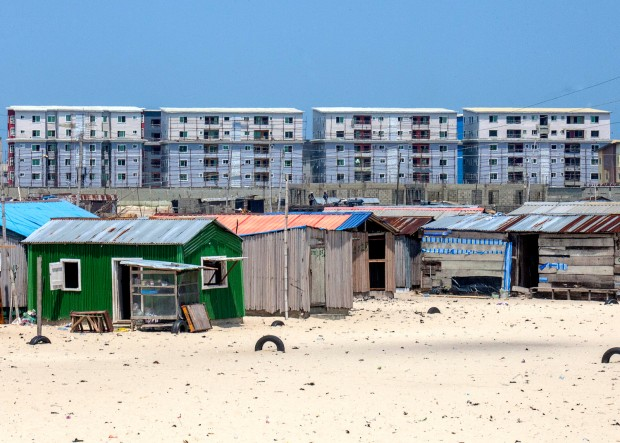 Otodo Gbame, Lekki, Lagos. A view of Otodo Gbamé, a fishing slum community tucked in fast up moving Lekki peninsular district in Lagos. It has experience various land conflicts because of the surge in land demands for the costly real estate proliferating Lekki. Over the course of two days, 500 homes were burned, two young men and three children were killed, and 14 people were injured. Image Credit: Andrew Esiebo.